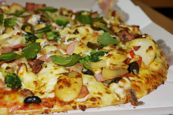 Have the Ultimate Domino's Pizza – All the toppings and Over $100!