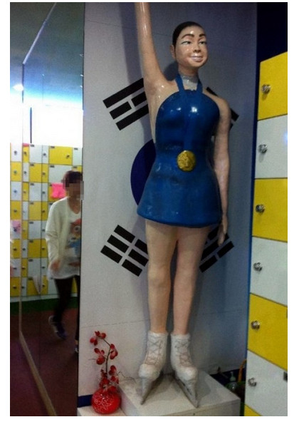 Sculptor Seems to Have Confused Beautiful Figure Skater Kim Yuna with the Dude from Sling Blade