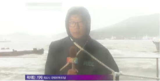 Daring Korean Reporters Rush out to Cover Dangerous Typhoon Gangnam Style
