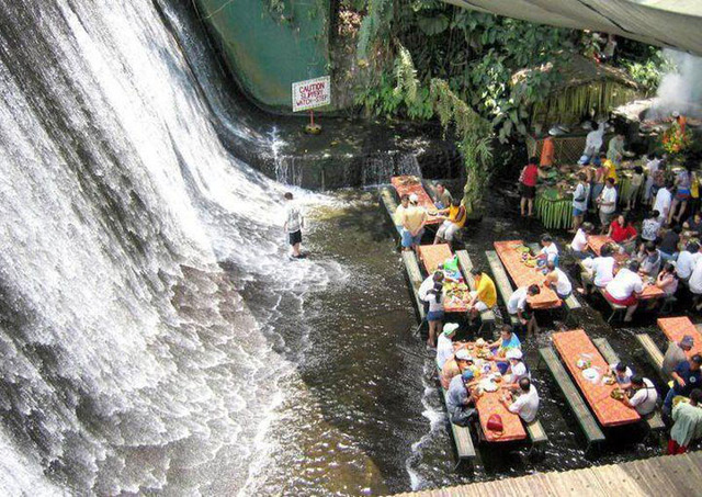 Paradise is Lunch at the Foot of a Beautiful Waterfall in a Coconut Plantation in the Philippines