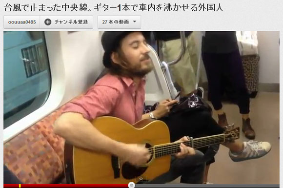Inspiring or Inconsiderate? Foreigner Plays Guitar for Frustrated Train Passengers While Stranded in Typhoon