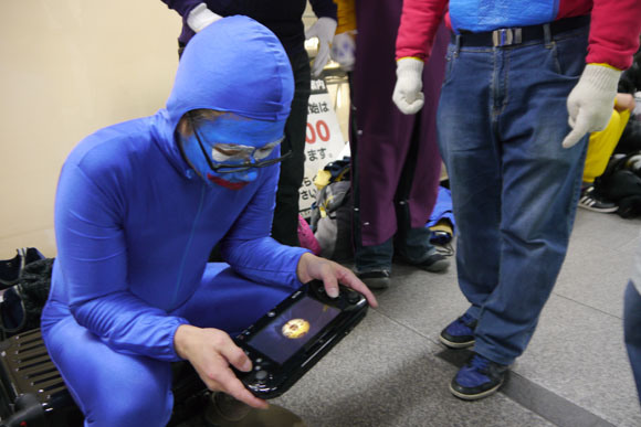 Mr. Sato Takes his Wii U to Play While Waiting in Line at the Wii U Release
