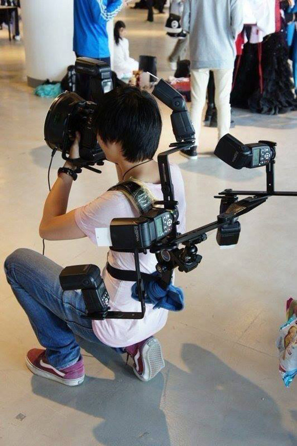 Young photographer and his gear steal the show at cosplay event, kind of looks like Doc Ock