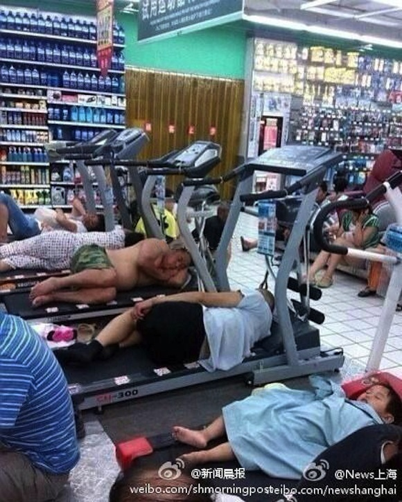 China in grip of heat wave, causes food to accidentally cook on the ground and people to sleep on treadmills
