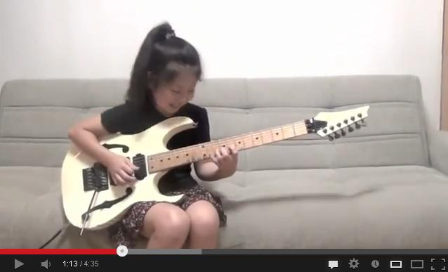 Eight-year-old girl astounds world with guitar technique