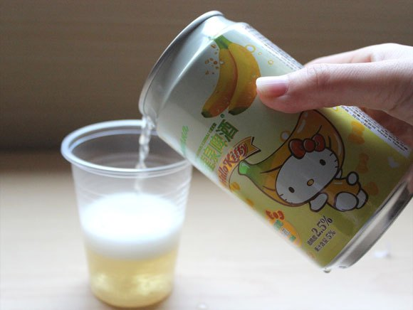 She doesn't need beer goggles to look cute, but we try Hello Kitty Beer anyway