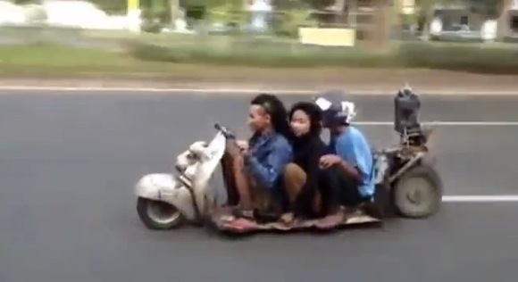Highway video from Southeast Asia shows three crazy motorists, one crazy scooter