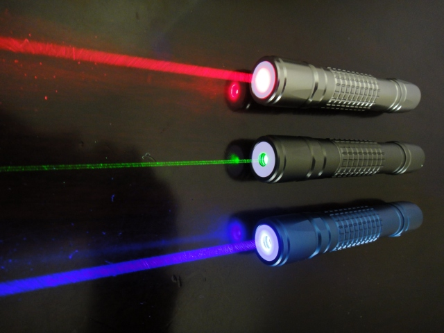 How far across the Tokyo sky can a laser pointer shine?