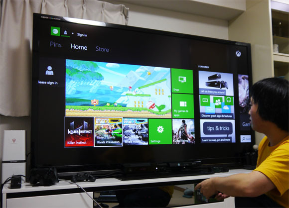 Using our brand new Xbox One console… to play New Super Mario Bros. Wii U