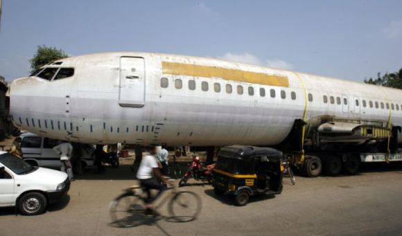 The fuselage of a Boeing 737 is parked on a road in Mumbai