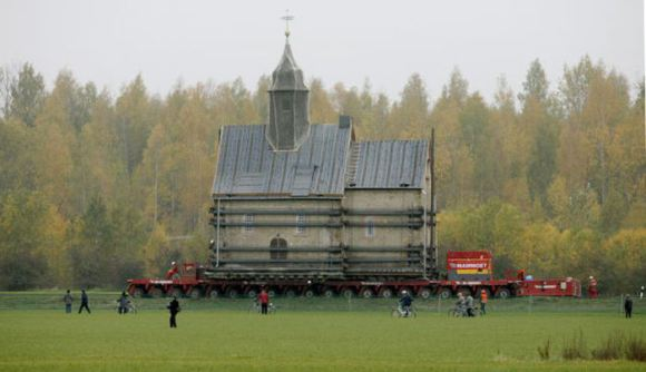 The Emmaus church is transported on a special trailer, after leaving the eastern German village of Heuersdorf