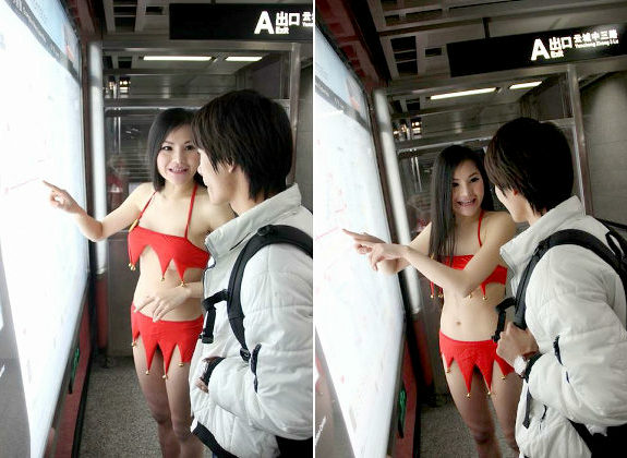Festive bikini-clad volunteer randomly giving directions in Chinese subway