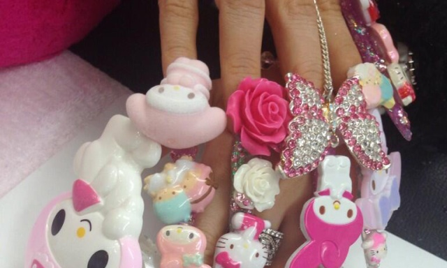 Young woman celebrates adulthood with dizzying Hello Kitty/My Melody nails