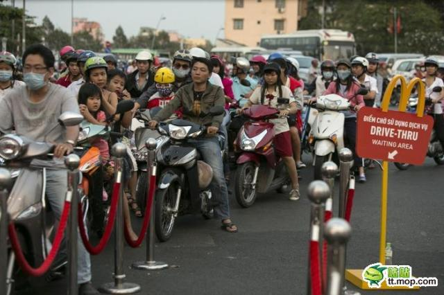 A flood of scooters at the drive-through marks the opening of Vietnam's first McDonald's