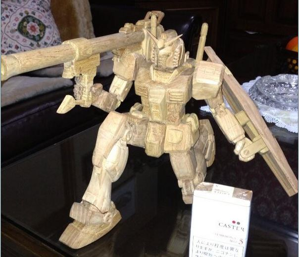 Hand-carved Gundam figure is ready for battle, bazookas and all