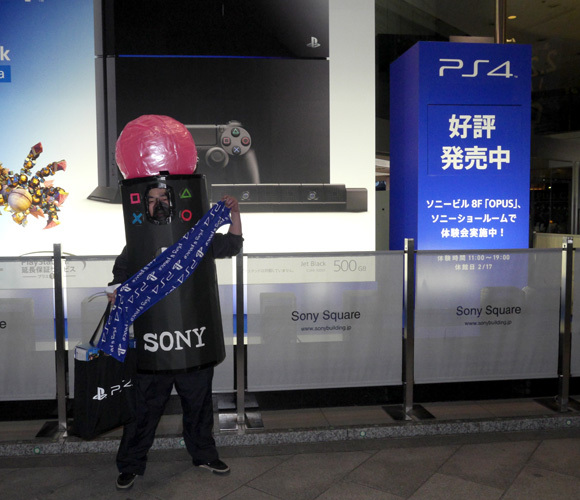 We try to get the first PS4 sold in Japan, and so does this guy dressed like a Move controller