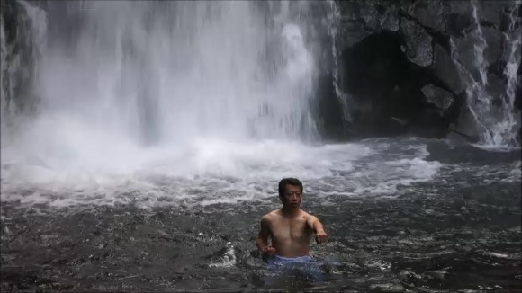 Karate dojo students practice under freezing waterfall… in the middle of winter