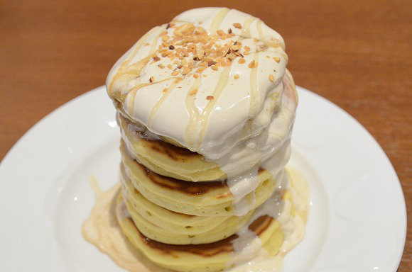 We resist the urge to climb Denny's Japan's Tower Pancake so we can eat it instead