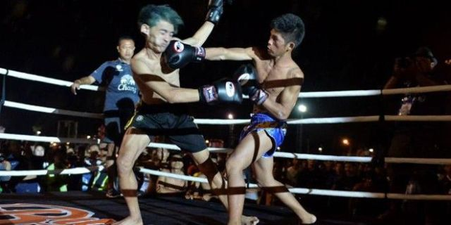 Local thugs forced to fight pro Muay Thai fighters as punishment during Thai New Year festival