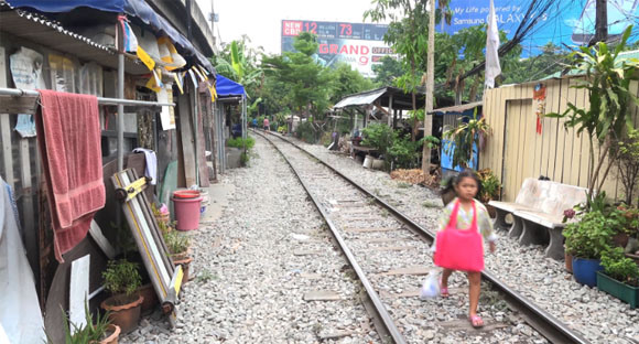 Residents of Bangkok neighborhood don't play by the railroad tracks, they live by them