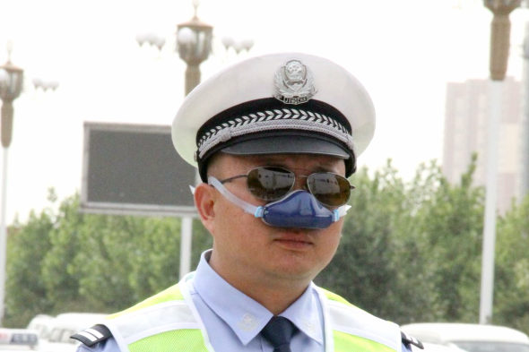 What's the deal with these new nose gadgets Chinese policemen are wearing?