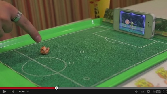 Neat idea turns fast food tray and smartphone into functional football game