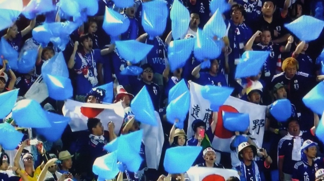 Japanese fans are waving around blue plastic garbage bags at today's World Cup match…