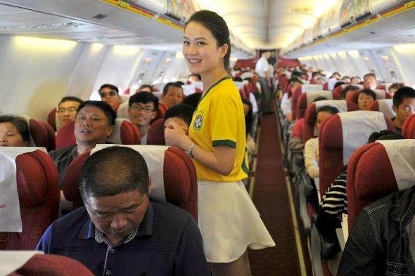 Chinese flight attendants wear team Brazil jerseys and mini-skirts to celebrate World Cup