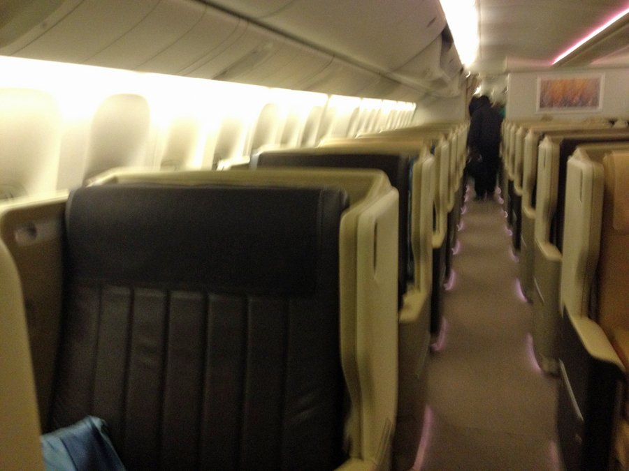 like-most-airplanes-you-have-to-walk-through-business-class-before-entering-economy-its-easy-to-get-jealous-of-the-large-comfortable-reclining-seats-and-private-pods