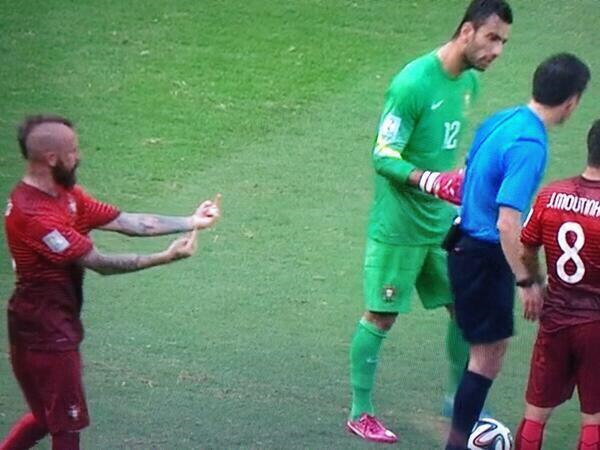 Did Portuguese soccer player flip off referee, or was he just looking for gold?