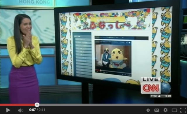 American newscaster can't stop laughing at crazy Japanese mascot