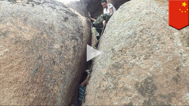 Real life 127 hours? Chinese woman gets stuck between giant rocks【TomoNews Video】