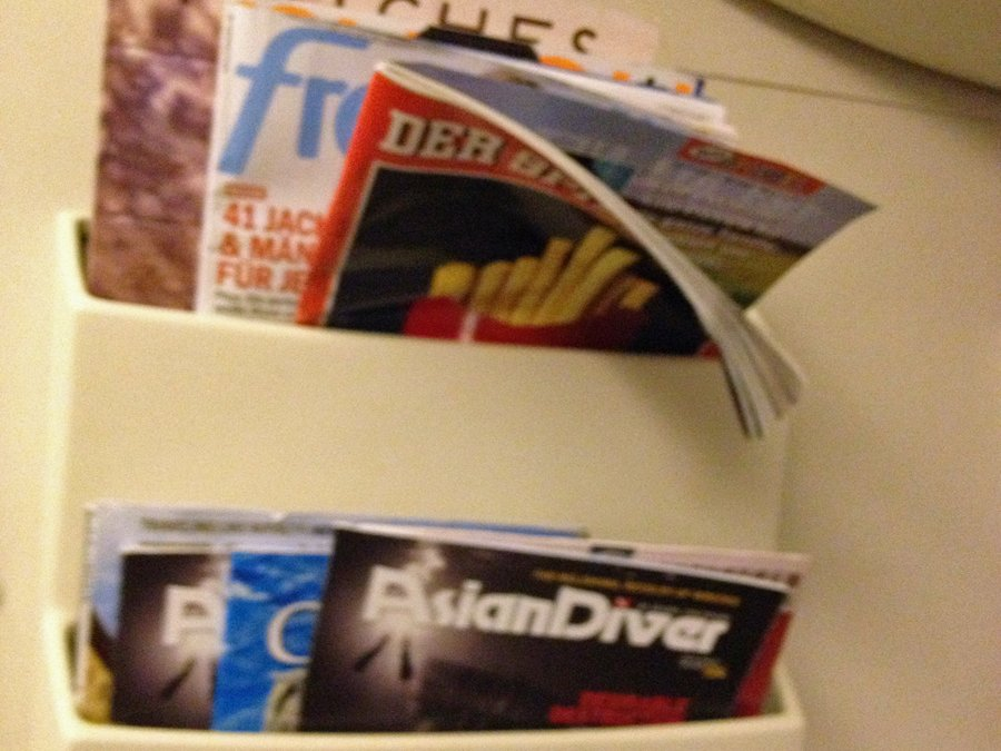 the-airplane-has-nice-touches-like-magazine-racks-filled-with-international-publications-for-fliers-to-peruse