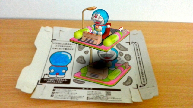 Japan's Glico lets snackers turn their empty boxes into augmented reality sets for Doraemon!