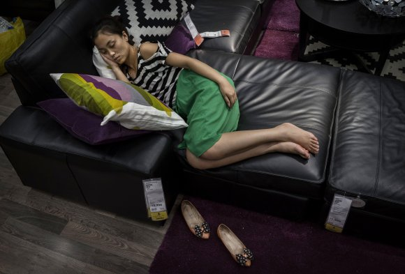 Bizarre photos of Chinese shoppers napping at Ikea6