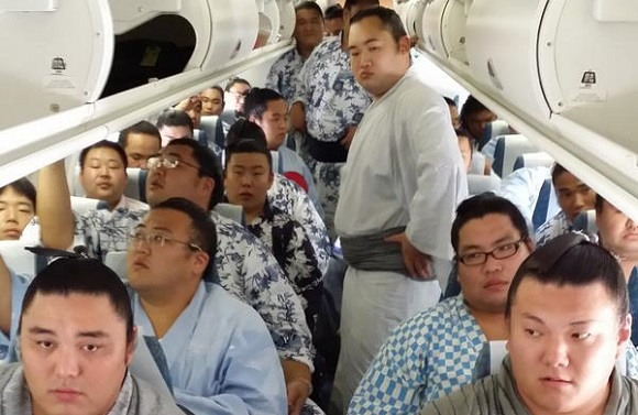 Some flights are more cramped than others – 29 sumo wrestlers pack into one tiny plane