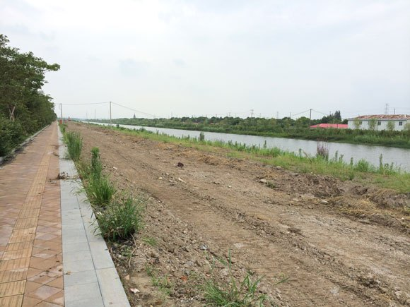 It opens next year?! We go to the Shanghai Disneyland site, find a lonely river in a field