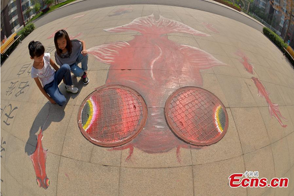 Manhole up! Local artist brings his creations to the streets