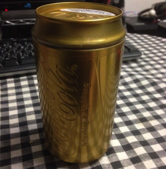 Japanese vending machine dispenses ultra-rare gold Coca Cola can prize