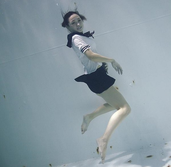 Time to get wet: Underwater photos of girls in sailor suits and… plastic exoskeletons?