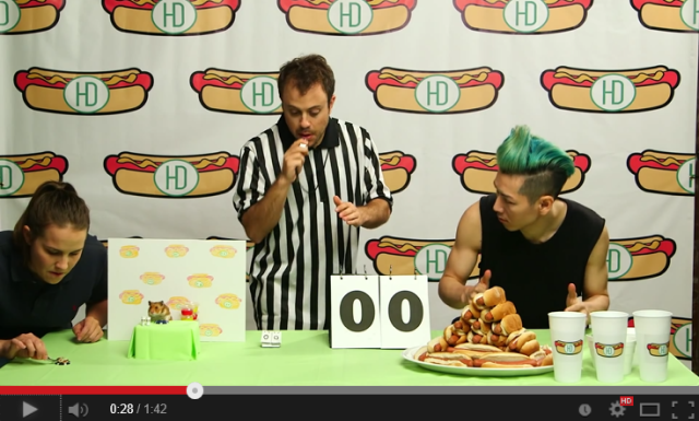 Man vs. Beast! Competitive eater Kobayashi takes on hamster in hot dog-eating contest 【Video】