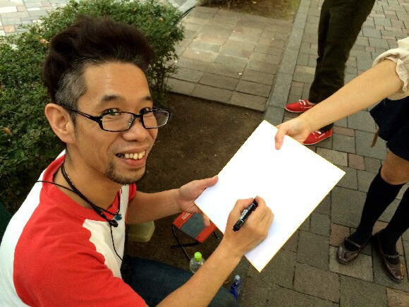 Mr. Sato gives his first ever autograph, gets a broken heart in return