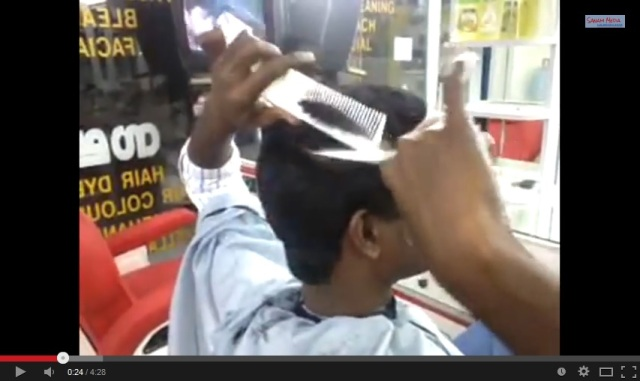 Now, that's spatial visualization! Indian barber cuts own hair with greatest of ease
