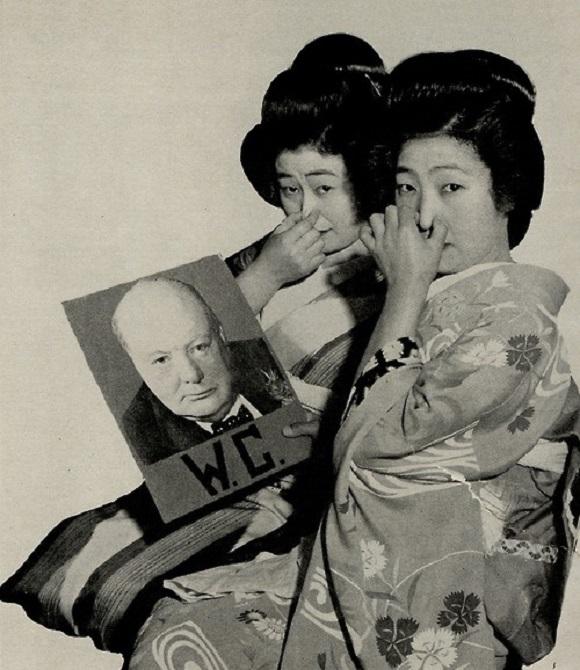 Anti-UK World War II era photograph featuring grimacing geisha uncovered