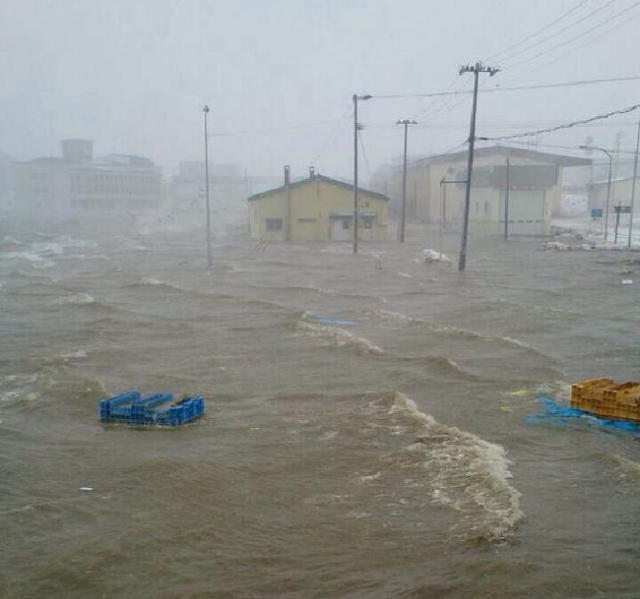 Evacuation orders issued as town in northern Japan is flooded by rising tidewaters