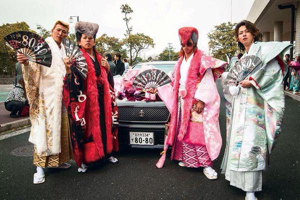 Japanese youths celebrate reaching adulthood with outrageous outfits and Elvis hair