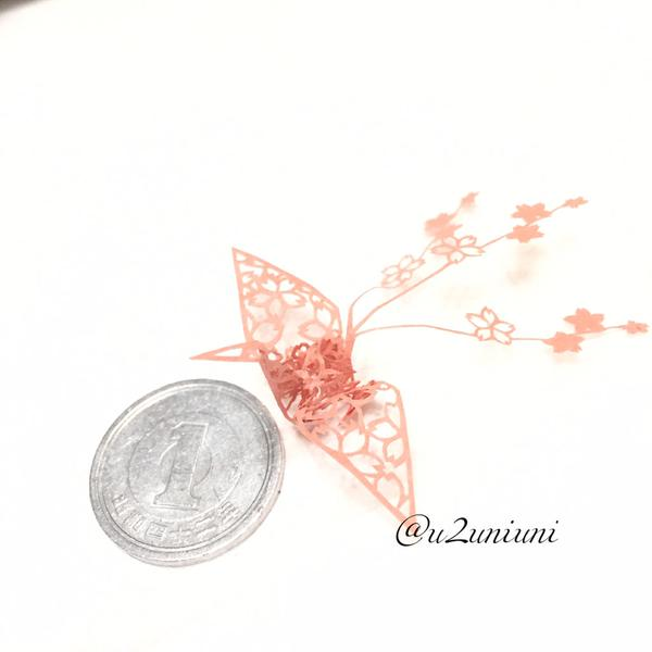 Skilled Japanese artist creates intricate cut-paper origami cranes