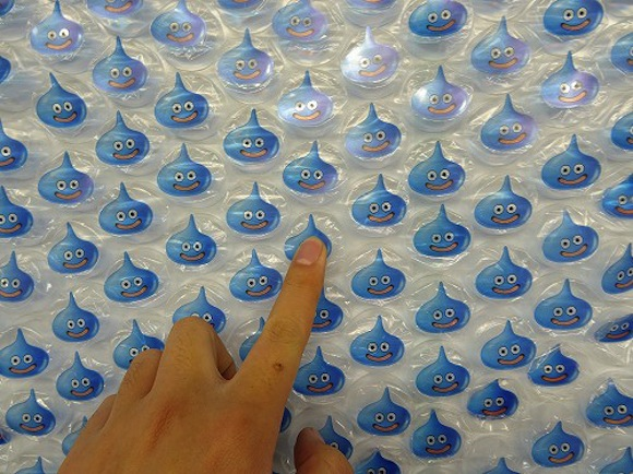 Wall of bubble-wrap Blue Slimes appears in Shinjuku Station to promote new Dragon Quest game