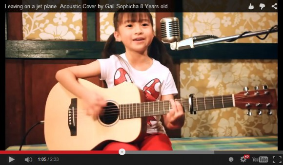 Talented eight-year-old Thai musician brings a tear to our eye with her angelic singing voice