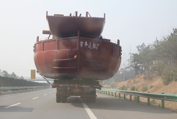 Chinese trucker hauling huge boat on highway attracts police, $32 fine and a lot of laughs